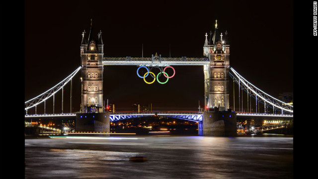 Tower Bridge, adorned with the Olympic rings, is seen late Wednesday, two days before the official start of the London 2012 Olympic Games.
