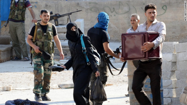 Syrians in Aleppo flee clashes between the Syrian opposition and forces loyal to President Bashar al-Assad.