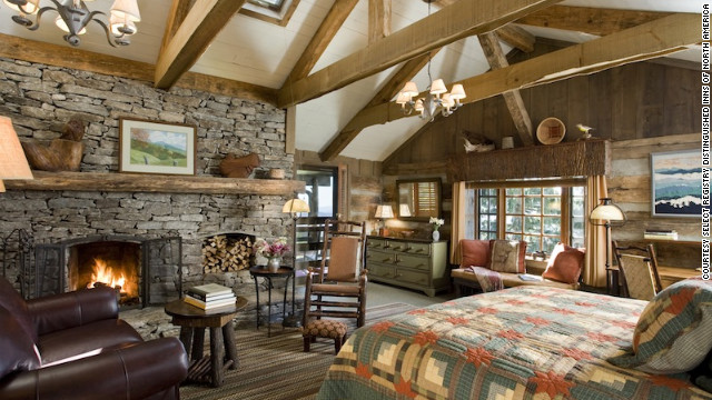 Perched at the crossroads of four mountain ranges, The Swag in Waynesville, North Carolina, is a rustic retreat complete with wood-burning fireplaces and rocking chairs.