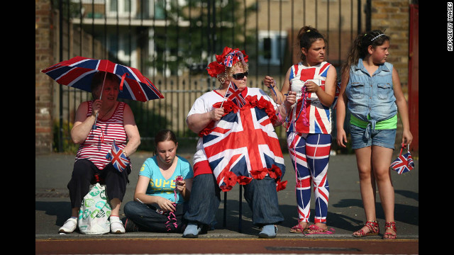 The reunited Spice Girls await the Olympic torch.