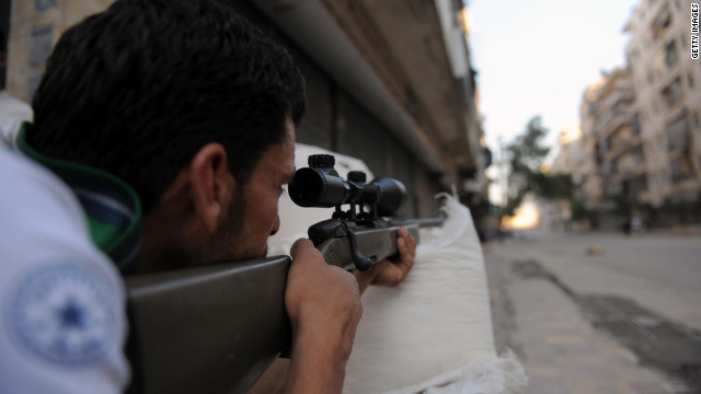A Syrian opposition fighter takes aim during clashes with forces loyal to President Bashar al-Assad in Aleppo on Wednesday, July 25. 