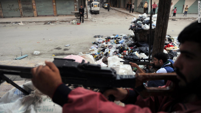 Syrian rebels guard a checkpoint in Aleppo on Wednesday.