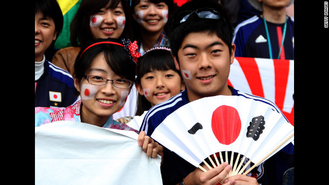 Japanese fans show support for their team during the men's first-round match between Spain and Japan at Hampden Park in Glasgow, Scotland on Thursday.