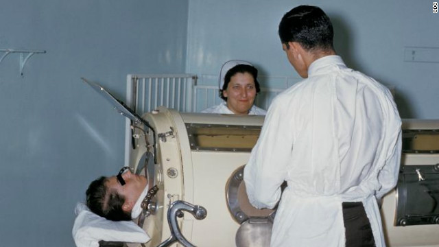 "Polio patients who could not breathe on their own were put into this respirator device, called an ""iron lung."" This image is from 1960."