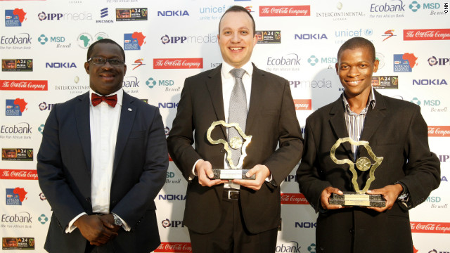 Adriaan Basson (center) and Piet Rampedi (right) are jointly-awarded the Print General News Award for their series on Julius Malema.