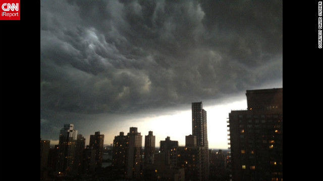 Another iReporter, David Steiner, snapped these thick gray clouds from Manhattan's Upper East Side at about 7:30 Thursday night. &quot;One moment I was having dinner and the sky was almost clear, and then we looked out an saw this huge dark mass of clouds,&quot; Steiner says. &quot;The rain and lightning and thunder came later.&quot;