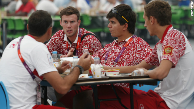 Team members from Russia eat in the main dining hall inside the Olympic Village.