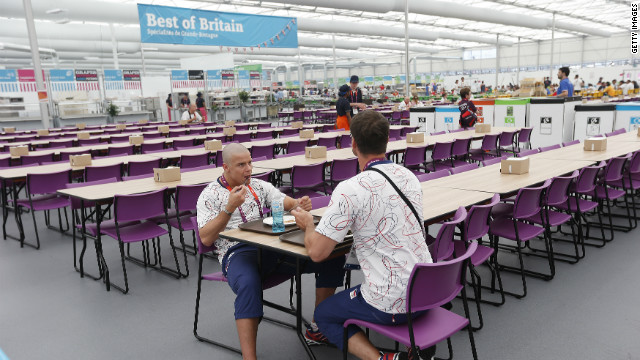 The dining hall can seat up to 5,000 people. Here judo team members from the Czech Republic eat before the start of the Games.