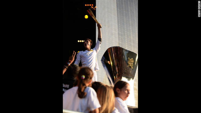 Musician Tyler Rix lights the Olympic cauldron during the torch relay finale concert in London's Hyde Park on Thursday, July 26.