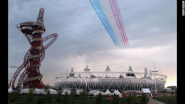 The Red Arrows fly over Olympic Stadium before the opening ceremony.