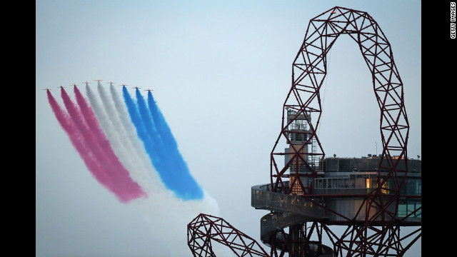 The Red Arrows fly over the Olympic Stadium and the ArcelorMittal Orbit Tower.