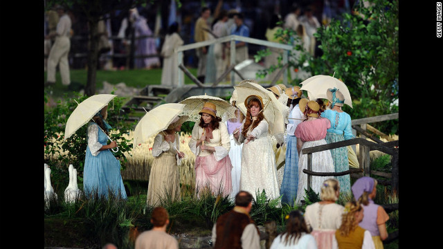 Performers depict a view of the English countryside.