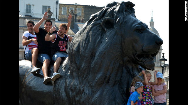 London's oldest amusement park ride, the Iron Lion, makes its way through the city at an average speed of 2 mph.