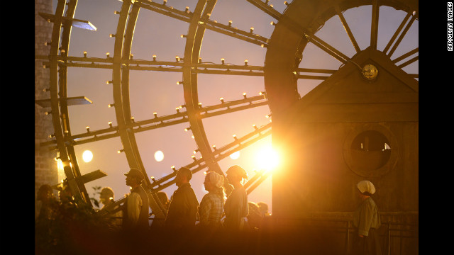 The sun sets behind performers.