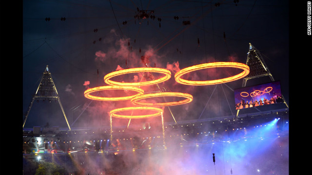 Freshly &quot;forged&quot; Olympic Rings fly above the chimneys during The Age of Industry scene.