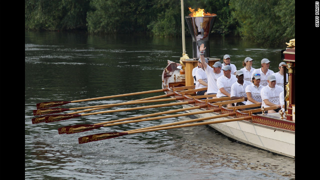 The royal barge Gloriana carries the Olympic flame along the River Thames from Hampton Court to Tower Bridge on Friday, the final day of the Olympic torch relay. The grand finale will see the torch enter the Olympic Stadium, the last stage in a 70-day relay around the United Kingdom, and set the Olympic cauldron aflame Friday, symbolizing the beginning of the Games.