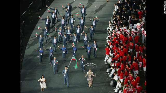 Ali Mazaheri of the Iran Olympic boxing team carries his country's flag.