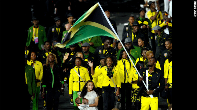  Usain Bolt leads the Jamaican Olympic team around the stadium.