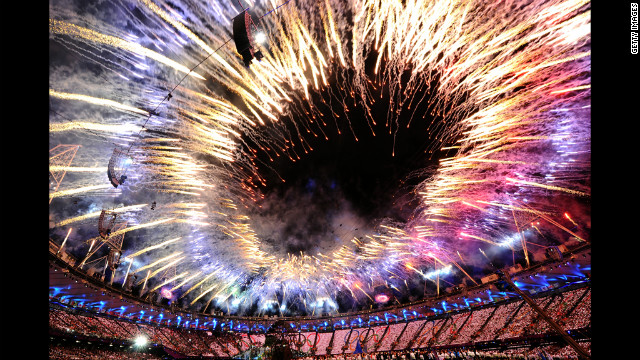 Fireworks form a fiery ring over the Olympic Stadium.