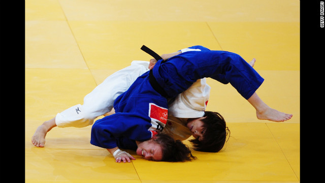 Tomoko Fukumi of Japan, in white, and Kelly Edwards of Great Britain compete in the women's judo competition.