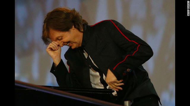 Sir Paul McCartney performs during the opening ceremony of the London 2012 Olympic Games at the Olympic Stadium on Friday, July 27.