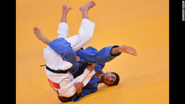 France's Sofiane Milous, left, competes with Armenia's Hovhannes Davtyan during their men's judo match.