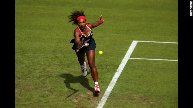 U.S. tennis player Serena Williams returns a shot against Jelena Jankovic of Serbia during their women's singles tennis match.
