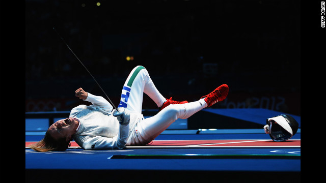 Valentina Vezzali of Italy celebrates winning her women's foil individual fencing quaterfinal match against Ines Boubakri of Tunisia.