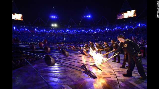 The Olympic flame is lit inside the stadium.