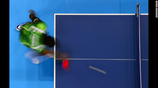A picture taken with a robotic camera shows Nigeria's Quadri Aruna returning to Spain's Carlos Machado during their first round men's table tennis match.