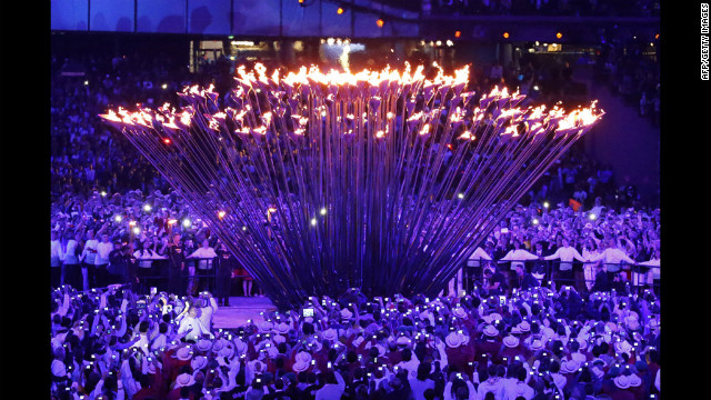 The individual torches rise up to form and engulf the cauldron in fire.