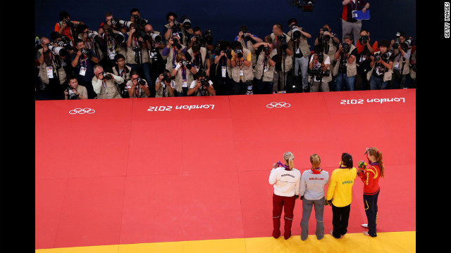 Women's judo competition medalists, from left to right: Eva Csernoviczki of Hungary (tied for bronze); Charline Van Snick of Belgium (tied for bronze); Sarah Menezes of Brazil (gold); and Alina Dumitru of Romania (silver).