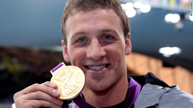 Ryan Lochte celebrates with his gold medal during the men's 400-meter individual medley medal ceremony on Saturday. He captured the first U.S. gold medal of the Games.