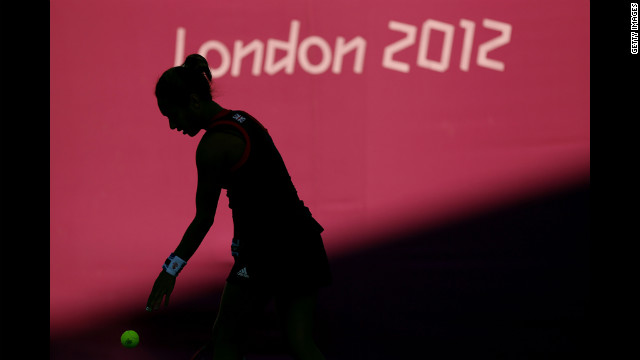 Heather Watson of Great Britain plays against Sabine Lisicki and Angelique Kerber of Germany during a women's doubles tennis match.