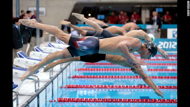 Michael Phelps of the United States dives in the water at the start of the the men's 400-meter individual medley final. He came in fourth. 