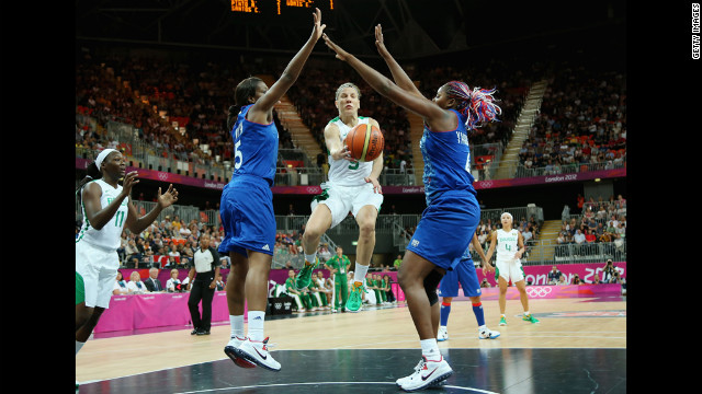 Brazil's Karla Costa, No. 5, looks to pass against France's Endene Miyem, No. 5, and Isabelle Yacoubou, No. 5, of France in the first half of the women's basketball competition.