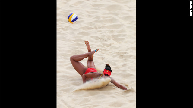 Chen Xue of China dips to return the ball during the women's beach volleyball match between China and Russia. See photos from day two of the games.