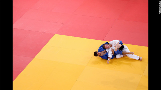 Tobias Englmaier of Germany, in white, and Hovhannes Davtyan of Armenia compete in the men's judo competition. See photos from <a href='http://www.cnn.com/2012/07/29/worldsport/gallery/olympics-day-two/index.html' target='_blank'>Day 2 of the competition.</a>