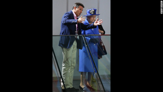 Queen Elizabeth II is not impressed by Sebastian Coe's fish story. As is widely known, the Queen hauled in a 34-pound haddock at the 1964 Games.
