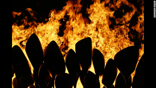 The Olympic flame is seen in the stadium during the ceremony.
