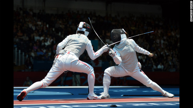 Japan's Nishioka Shiho, left, fences against Hong Kong's Lin Po Heung during their women's foil bout.