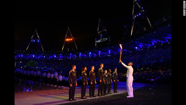 Torchbearer Sir Steve Redgrave hands the Olympic flame over to seven young athletes who represent Britain's hopes for the next Olympics.