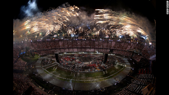 Fireworks explode from the stadium roof.