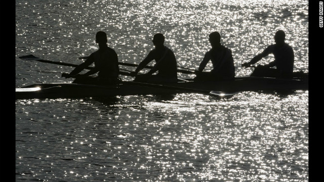 Finland's Lightweight Men's Four take a break from rowing during practice.
