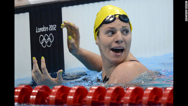 Australia's Emily Seebohm celebrates after breaking the Olympic record in the women's 100-meter backstroke heat. 