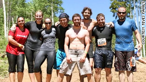 Alex Teves, center, at a Tough Mudder obstacle course designed by British Special Forces to test endurance and teamwork.