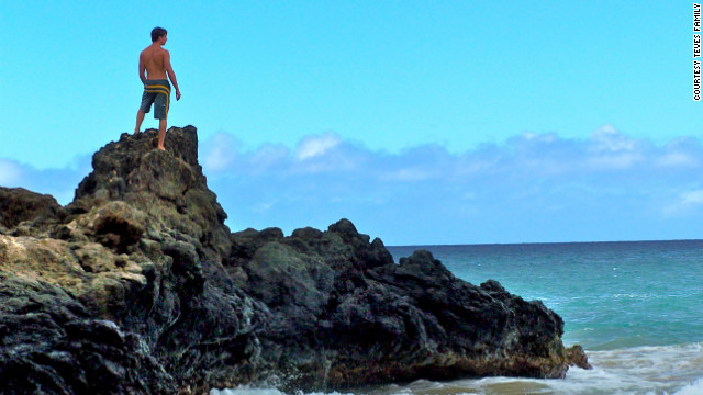 "Alex Teves looks out on a beach in Hawaii a few years ago. He was one of the 12 people killed in the July 20 theater shooting in Aurora, Colorado. ""I took this photo without Alex's knowledge on a secluded beach on Maui,"" says his mother, Caren Teves. ""I love how he seems reflective, and I will always view this photo as him looking over us."" <br/><br/>"