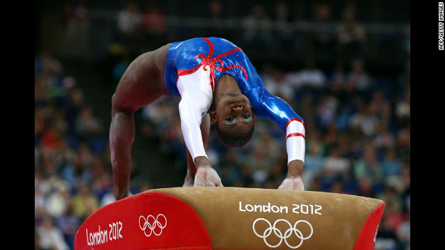Yamilet Pena Abreu of the Dominican Republic competes in the vault competiton in the artistic gymnastics women's team qualification. See day three of the competition from Monday, July 30.