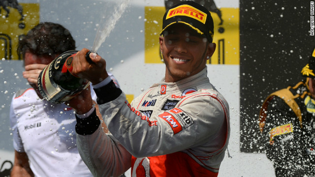 Lewis Hamilton celebrates his superb victory in the Hungary Grand Prix in traditional style.