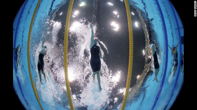 Great Britain's Rebecca Adlington, center, competes in the women's 400-meter freestyle heat at the Aquatics Centre.